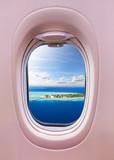 Airplane window view of Maldives islands - 249094024