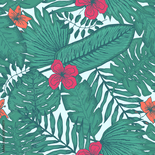Tender green seamless pattern with colorful tropical leaves and flowers on light blue background. Trendy exotic plants texture for textile, wrapping paper, surface, wallpaper, background © Tatahnka