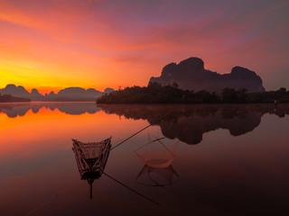 Fishing man at lakeside  © Niyada