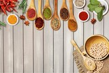 Various colorful spices on wooden table - 249110834