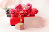 pink tulips and decorative gift box with a bow for the holiday of March 8