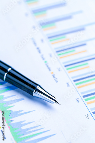 pen,glasses and calculator on Financial accounting stock market graphs analysis chart - 249125848