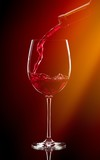 Pouring Red Wine into a Glass - 249129456