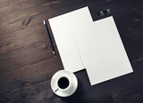 Photo of blank letterheads, coffee cup and pencil on wooden background. Space for text. Flat lay. - 249129880