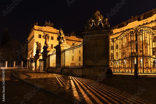 fototapeta na ścianę Main Gate of Prague Castle with Statue of Battling Titans, Hradcanske Square at night, Prague, Czech Republic