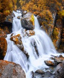 Autumn view of a waterfall in the mountains of Altai region, Siberia, Russia