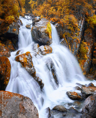 Autumn view of a waterfall in the mountains of Altai region, Siberia, Russia - 249143440