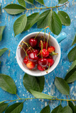 Fresh cherry in cup on top view