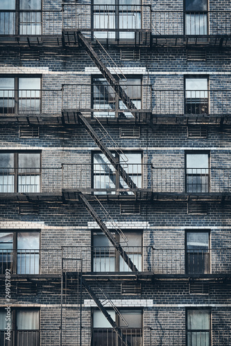 Old building with fire escape, color toned picture, New York City, USA. - 249157892
