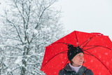 Sad disappointed woman in snow under umbrella - 249160415