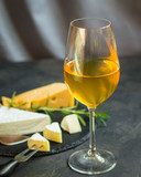 white wine in a transparent glass and snack. food background. top photo - 249168404