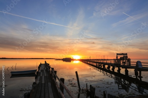 Foto Murales romantic pier in Wackerballig by the Baltic Sea at sunset