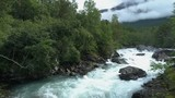 Aerial of a wild forrest river in the mountains. Upstreams and uprising view. - 249198099