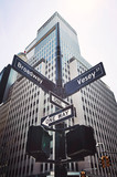 Looking up at Broadway and Vesey street sign, retro color toning applied, New York, USA.