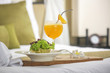 A portion of avocado salad with lettuce and freshly squeezed orange juice served in a hotel room, room service, healthy start of the day - 249203014