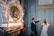 A wonderful and stylish wedding couple charismatically dancing in the classical hall