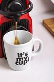 Red espresso coffee machine pouring coffee on a white decorated mug - 249238625