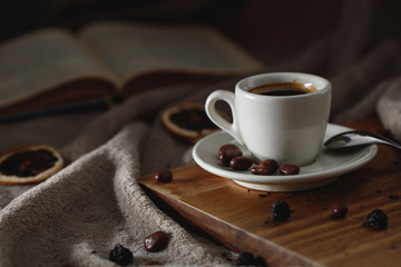 Cup of coffee, a book and wrap: concept of winter relaxation