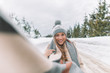 Quadro Beautiful blonde girl with comforter and hat posing in snow