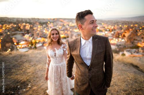 Beautiful wedding couple posing on peak near Cappadocia
