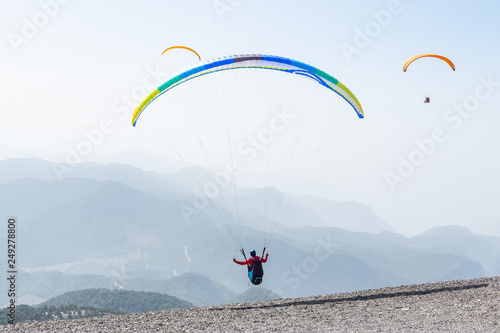 Paragliders pilots take off from the top of Babadag mountain, Oludeniz, Turkey © x e n i a