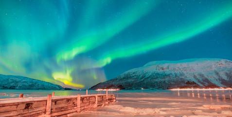 Northern lights in the sky over Tromso,  Norway © muratart