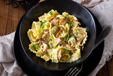 Reginette noodles in cream sauce with fresh chanterelles and capers - 249290875