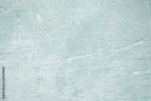 Old blue scratched wall background or texture
