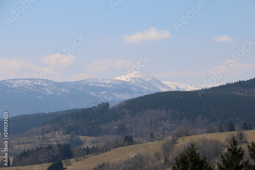 Rudawy Janowickie Mountains during spring. Karkonosze Mountains, Śnieżka Mountain (snow-covered) in the background. Sudety. Spring in the mountains. Lower Silesia, Dolny Śląsk, Poland, Polska, Polen
