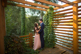 Beautiful wedding couple posing outdoor in forest on wooden dock - 249294251