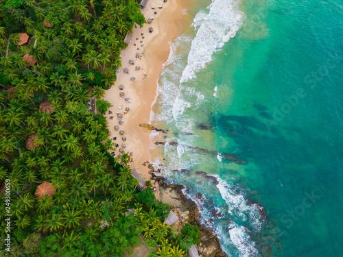 Leinwandbild Motiv Romantic sunset on a tropical beach with palm trees