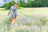 Unity with nature, walk on a cornflower field