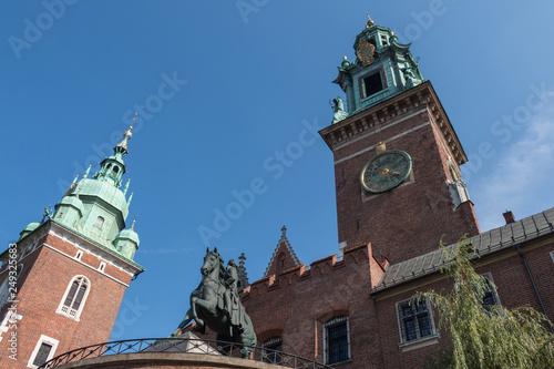 Wawel Royal Castle in Krakow Poland, with Tadeusz Kosciuszko Monument in front