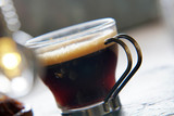 Close up of freshly brewed coffee in glass cup
