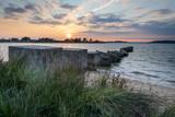 World War II tank defence blocks at Studland Bay  at sunset - 249350204