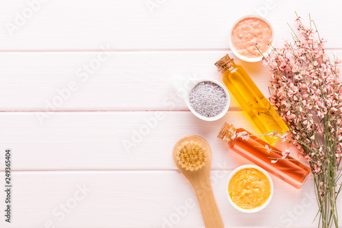 Beauty and fashion concept with spa set on pastel rustic wooden background. © gitusik