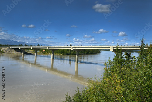 The Tanana River and bridge over Tanana river in Alaska Range - The landscape around Alaska Highway, Alaska, USA