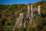 Medieval castle in Rhine river hills in autumn.
