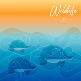 Wildlife Day card of turtles swimming underwater