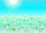 ピンク色の花咲き誇るキラキラ春の草原