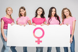happy women holding large sign with female symbol isolated on grey - 249525694