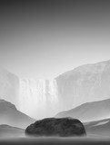 black and white image of a mountain landscape with a waterfall