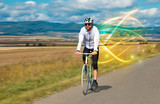 Young cyclist riding bicycle with magical landscape and concept - 249560821