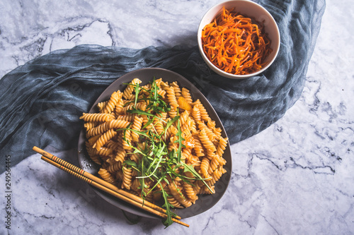 Pasta with spicy tomato sauce and herbs - 249564445