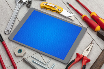 Household tools and tablet with grid screen concept  © ra2 studio