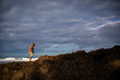 woman walking on rocks on beach in costa rica at the Caribbean