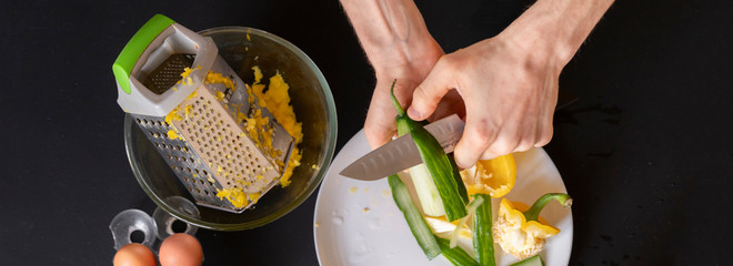 chef preparing salad from cucumbrer and other vegetables b © Mihail