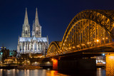 Cologne skyline with Cologne Cathedral and Hohenzollern bridge at night - 249616036