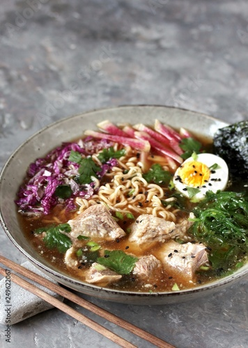 Asian ramen soup is beautiful with beef brisket, purple Peking cabbage, watermelon radish and algae. Asian cuisine. copy space. place for text.  - 249622067