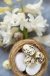 Easter holiday.Easter decorative nest close-up and white hyacinth flower on gray background